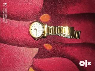 Urgent sell Titan watch with date facility